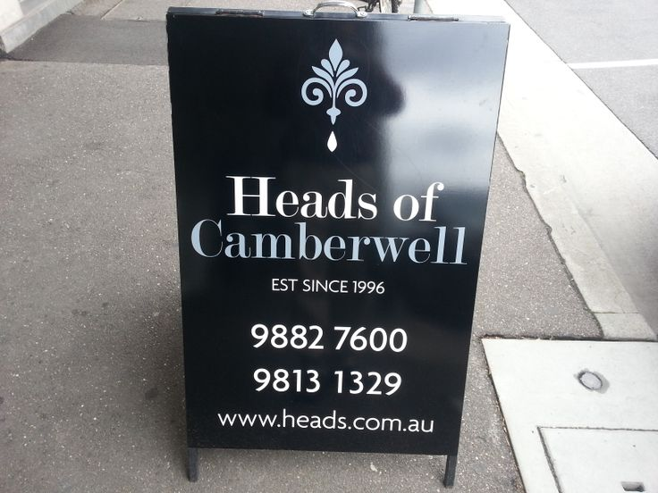 A-Frame provided for Heads of Camberwell by designed and applied by Sign A Rama Box Hill. A Black background always helps to create strong contrast.
