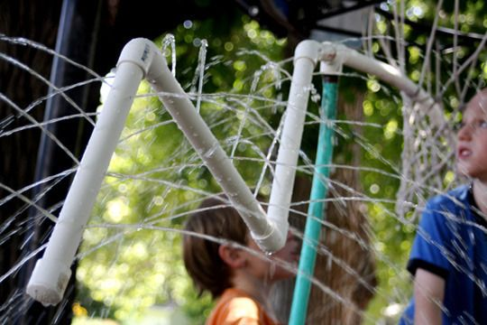 DIY PVC home-style water park.  Connect a hose to PVC that has holes drilled throughout and hang the structure so kiddos can run through.
