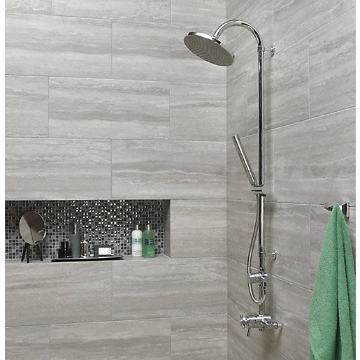 These contemporary Wickes grey wall and floor tiles combine the linear look of vein cut stone with the practicality of hard wearing, low maintenance glazed porcelain tiles.