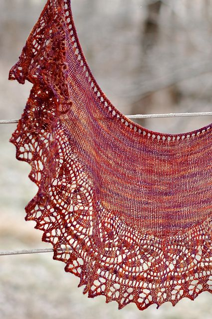 Ravelry: Regina Marie pattern by Sara Burch, free pattern. Cables, dayflower lace, and a leafy edging adorn the edge of this crescent-shaped shawlette, perfect for that special small skein. The narrow lace border is worked long-ways, using a method of keeping live stitches on the needle that eliminates the need to pick up stitches for the body of the shawl.