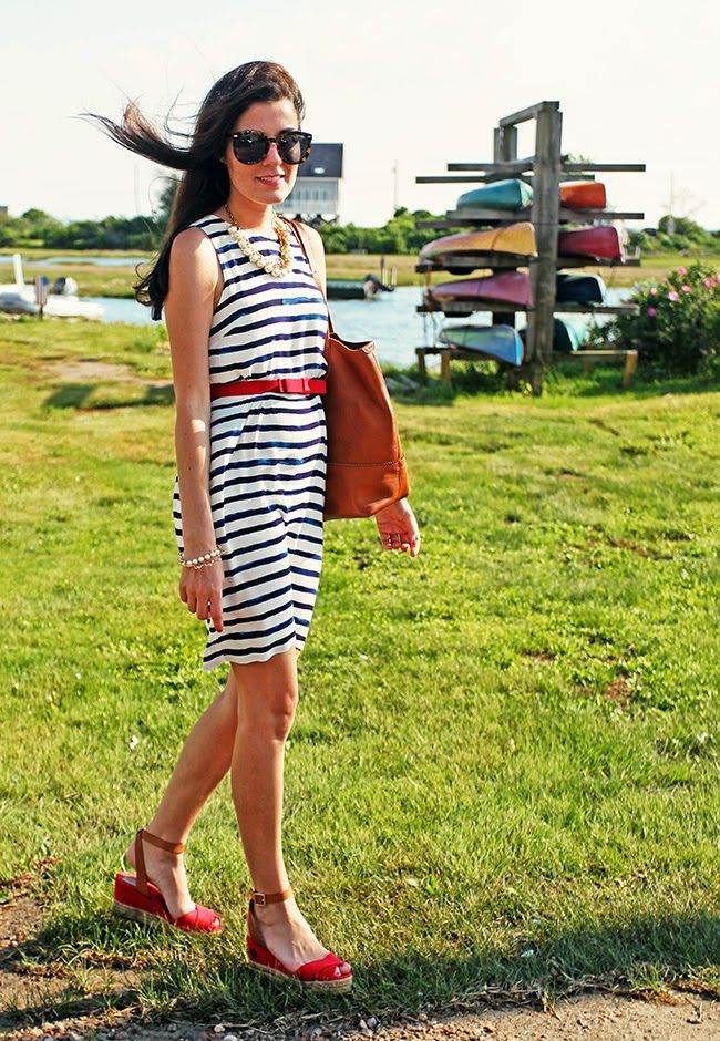 Dress by Joules, belt by Milly, shoes by Tory Burch, bag and necklace by J.Crew, glasses by Karen Walker. (June 16, 2014)