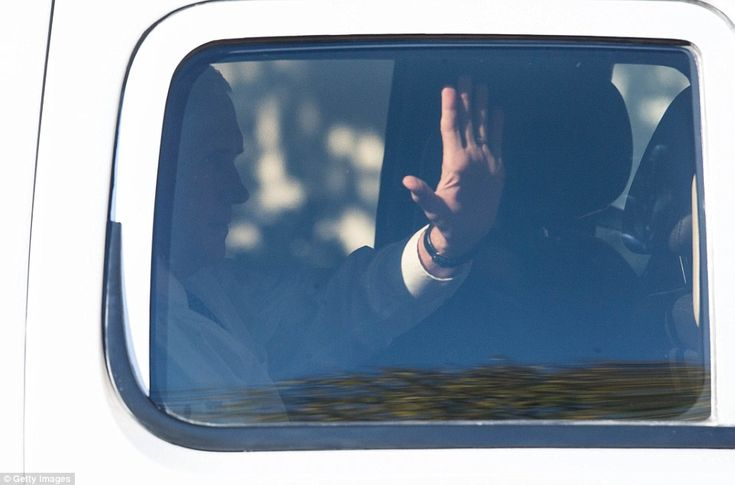 Vice President-elect Mike Pence waves as his motorcade arrives at the Capitol Hill Club on...