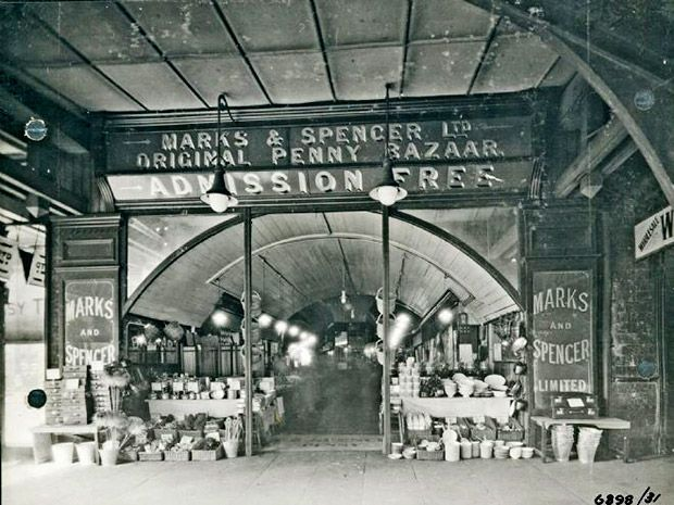 The result of a partnership between the Russian émigré Michael Marks and Skipton-born Thomas Spencer,  Marks and Spencer first started trading in Kirkgate Market, Leeds, in 1884... with their first London outlet opening in 1903 at Arch 574 on Brixton Station Road. Located in a railway arch of 'considerable depth,' the Marks and Spencer Brixton 'Original Penny Bazaar' stacked its goods up in front...