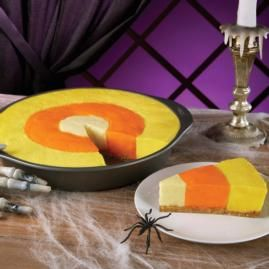 A delicious cheesecake made to resemble Halloween candy corn.