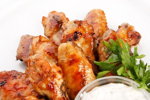 These 4 Baked Chicken Wing Recipes Will Have You Ready To Tailgate Fast