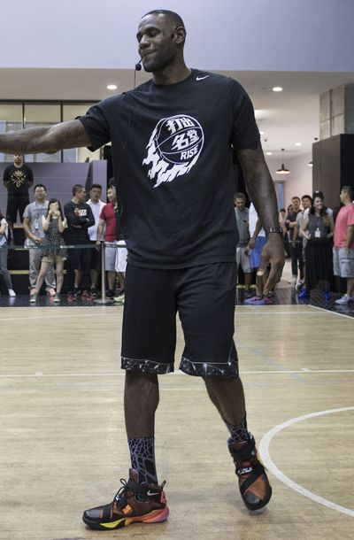 Lebron James at Nike Rise Event wearing Nike rise Lebron t-shirt and Nike lebron 9 soldier rise