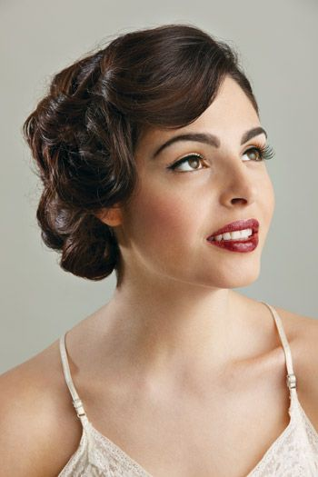 "Hollywood Glamour    Hair: Vittoria Monterosso at Salon V  Makeup: Valerie Guglielmo, Vis a Vis Artistry    This loose-wave updo evokes movie stars from the past; it's a sexy look that never goes out of style. ""I wanted to give her a 1940s glamour, a pin-up model look, but I added modern touches with lash extensions and glossy lips,"" Guglielmo says."