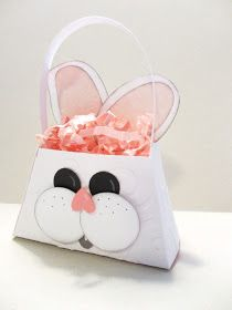The petite purse makes a sweet little bunny basket. It won't hold many treats, but it's stinkin' cute! :)