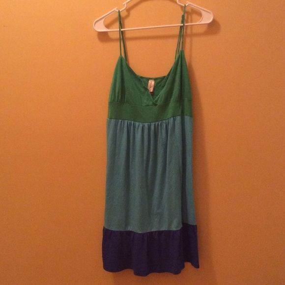 Adorable green, aqua and blue sundress Adorable green aqua and blue sundress with adjustable spaghetti straps. This is in great condition and could also be used as a bathing suit cover-up. No Boundaries Dresses