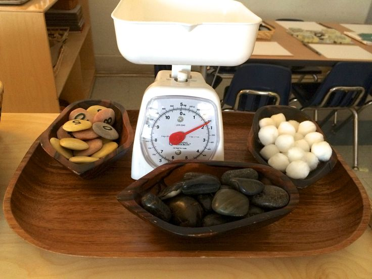 math activity tray for weight, can change or add materials each day, or have students collect materials from outside or from home to weigh