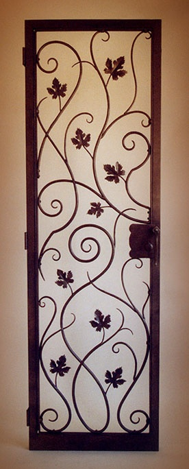 Wine room door.  I'd love this leading into a sunroom, or a greenhouse, a guest house, oh heck, just out into the backyard.