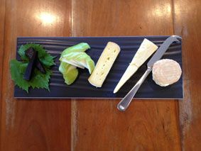 Cheese Plate ($18) - selected artisan cheeses, seasonal fruit, quince paste & crackers.