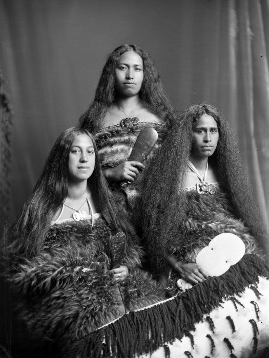 Mrs J A Jury is probably the wife of John Alfred Te Whatahoro Jury (Te Whatahoro) of Papawai; however, Te Whatahoro had nine wives over a period of fifty years, and there is no information about which wife the woman in this photograph may be. The moko of the woman on the right identifies her as Te Aitu-o-te-rangi Wikitoria Jury (daughter of Te Whatahoro Jury).
