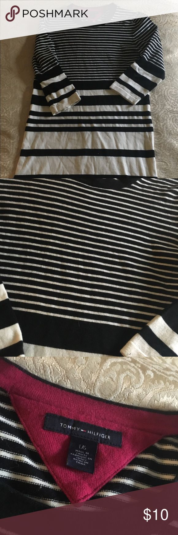 Tommy Hilfiger Sweater Dress Black and white sweater dress  Size large but more of a medium  Tommy Hilfiger knit dress.  Great with leggings!   Hardly worn Tommy Hilfiger Dresses Midi