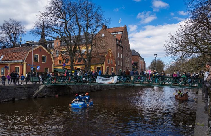 Valborg in Uppsala - The boat race goes throughout all the town (as the river does) passing one of the most beautiful buildings here. shared with pixbuf.com
