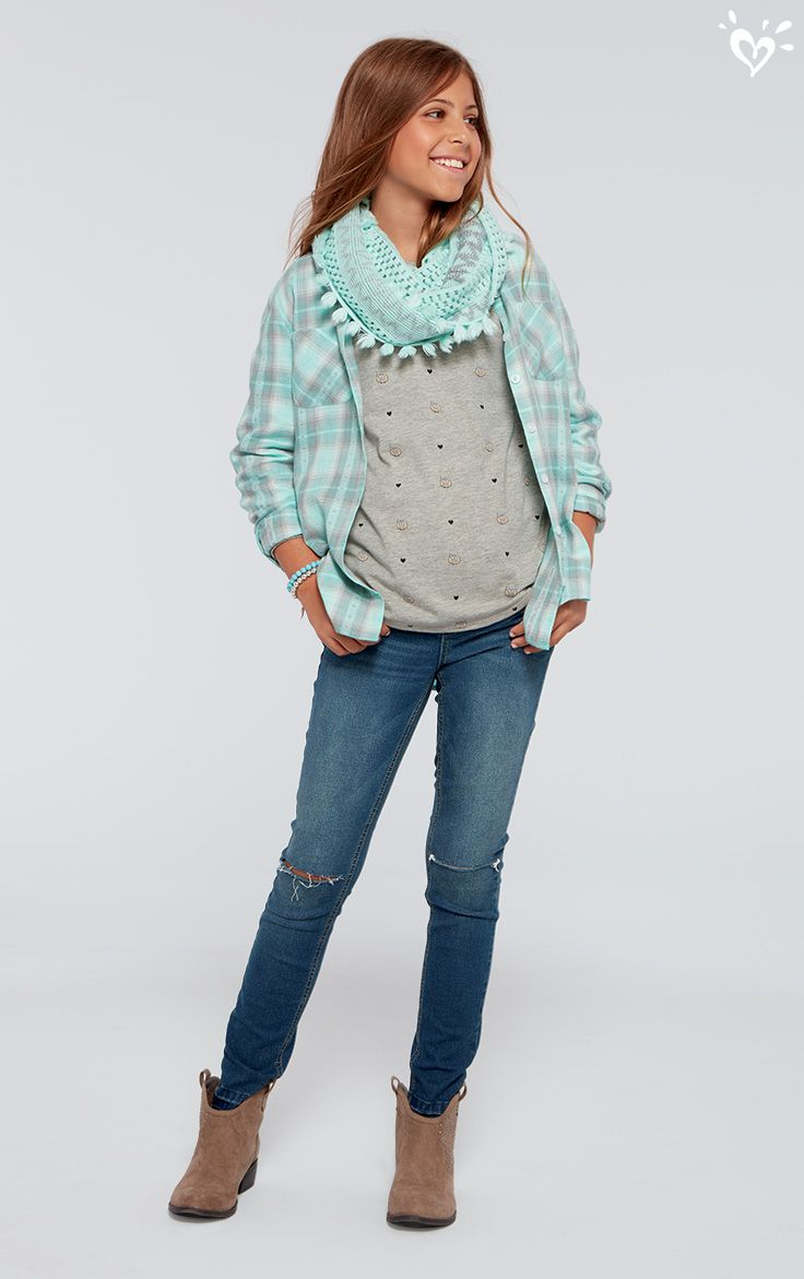 Slit knee jeans add a touch of rugged cool to a put-together scarf and plaid outfit.