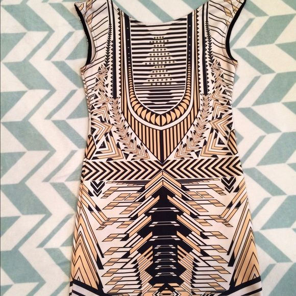Aztec Print Mini Dress This gold, white, and navy mini dress is perfect for nights out. Size medium with a slimming pattern, and so fun you can pair it with minimalist jewelry and heels. Low back. I always got compliments when I wore it out! Dresses Mini