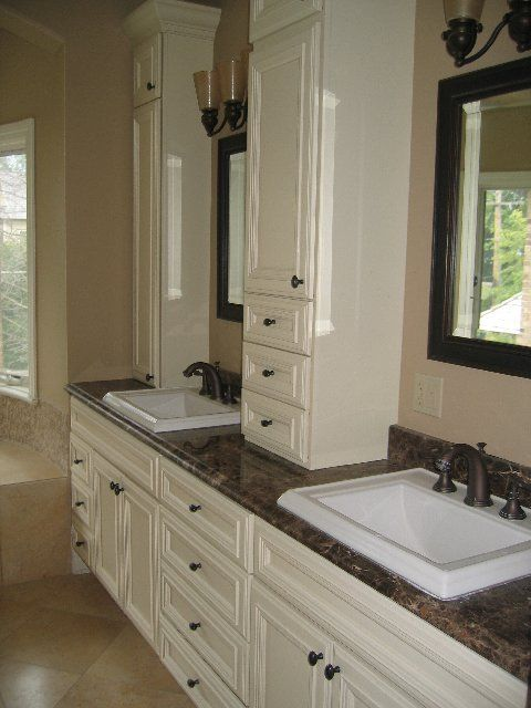double vanity with cabinet on top of countertop!  I like the sinks, but I think there would be more countertop space with undermount units.  Plus, easier to keep clean.