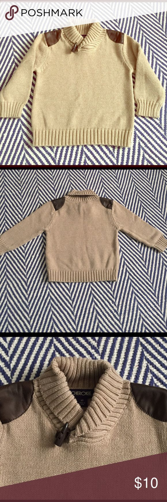 Boys Cherokee sweater Adorable Cherokee brand sweater. Light brown-tan color with dark brown leather-like material on shoulders . Only worn once and in excellent condition. Size 2T. Cherokee Shirts & Tops Sweaters