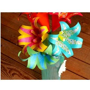 Teens will love making this Paper Tropical Flowers Bouquet to decorate their room or to give as a gift for Mother's Day or a special birthday. The flower colors can be as original as the supplies y...