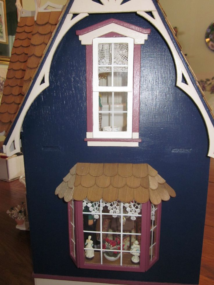 A view of the side windows of the house the shingling over the small window