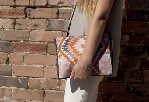 styled by: secret south.    Gemma clutch - orange kilim