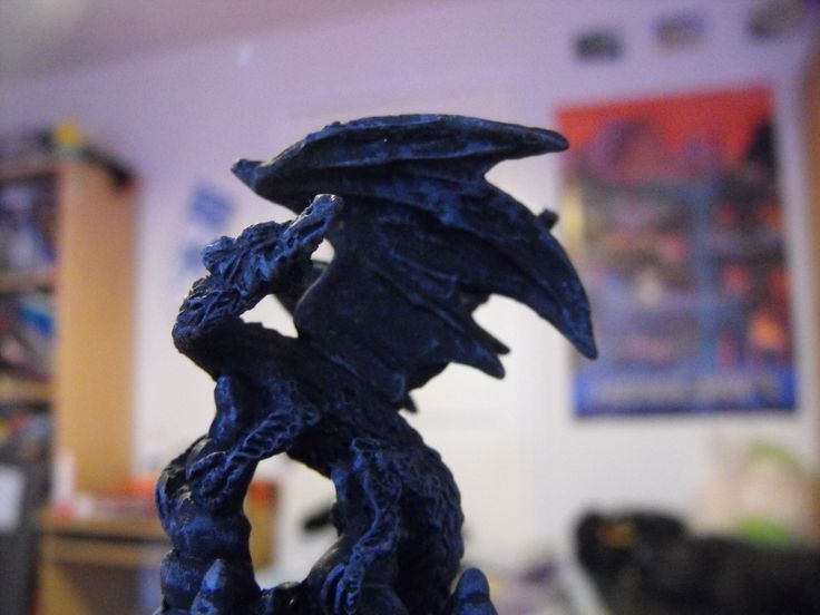 My dragon statue :D Ignore my bookshelf and my messy desk and Minecraft poster in the background.