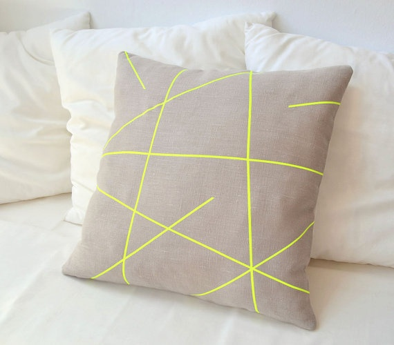 Loving this neon yellow/beige thing right now. Thinking a neon pillow on my khaki couch?