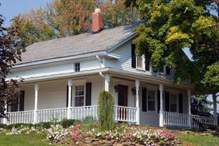 Amish farmhouse with large porch.