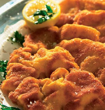 Recipe for Wiener Schnitzel - Schnitzel is a traditional Austrian dish consisting of boneless meat coated in breadcrumbs and fried. It is a popular part of Viennese and Austrian cuisine, also popular in Germany. Although the traditional Wiener Schnitzel is made of veal, it is now often made of pork or chicken.