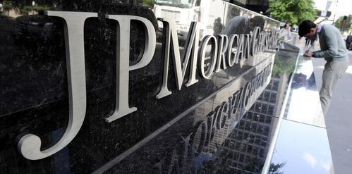 A file photo shows a view of a sign at a JPMorgan Chase building in New York. (Justin Lake, EPA)(Photo: JUSTIN LANE, EPA)      JPMorgan reported strong first-quarter results, topping Wall Street's forecasts for earnings and revenue handily, and the bank's CEO Jame Dimon gave... http://usa.swengen.com/jp-morgan-tops-profit-forecasts-says-consumers-healthy/
