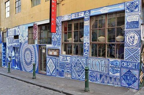 MoVida on Hosier Lane covered in the artwork of Lucas Grogan