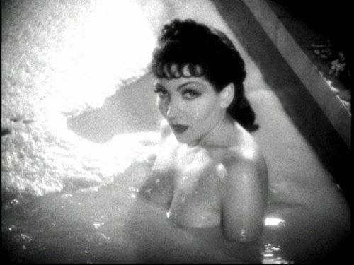 Claudette Colbert in the famous milk bath scene from Cecil B DeMille's Sign of The Cross. All part of the Nudge Wink and In Your Face attitude of Pre-Code