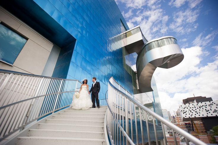 Art Gallery of Ontario bride and groom blue glass wall