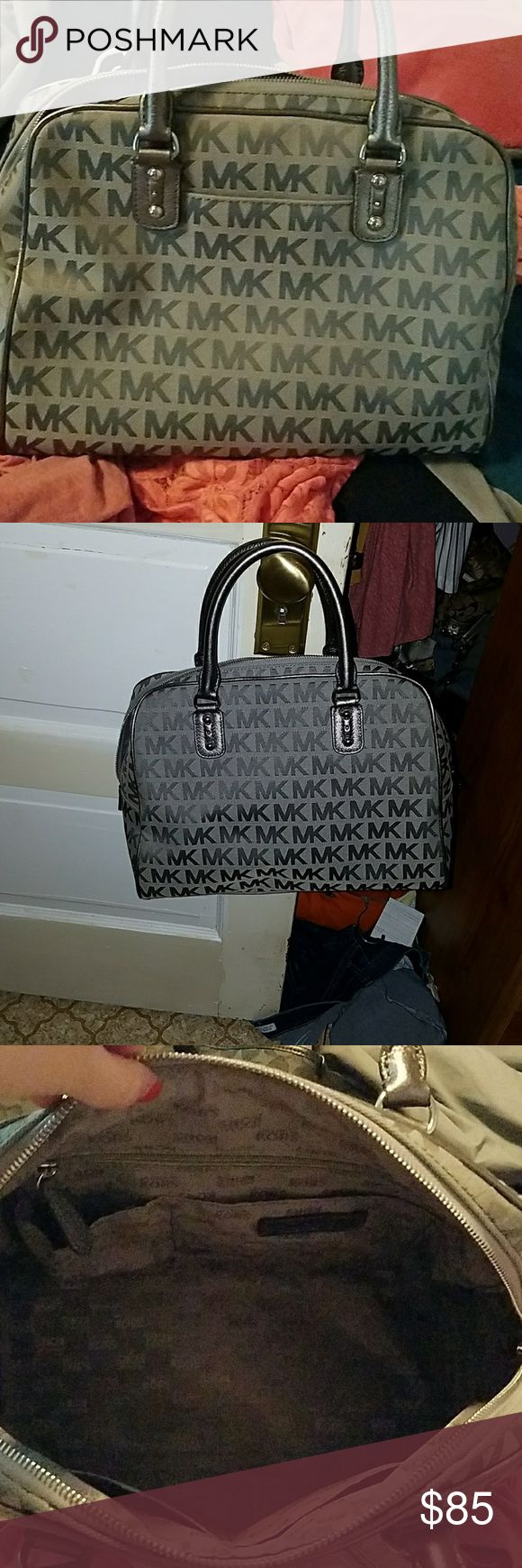 Michael Kors handbag Gray Michael Kors handbag. Missing strip to make into a crossbody. 4 pockets inside plus a zipper pocket inside. One slip pocket on the outside. Bought about 2 months ago, used once. Michael Kors Bags Totes