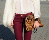White fur jacket, bordeaux jeans and animal printed clutch