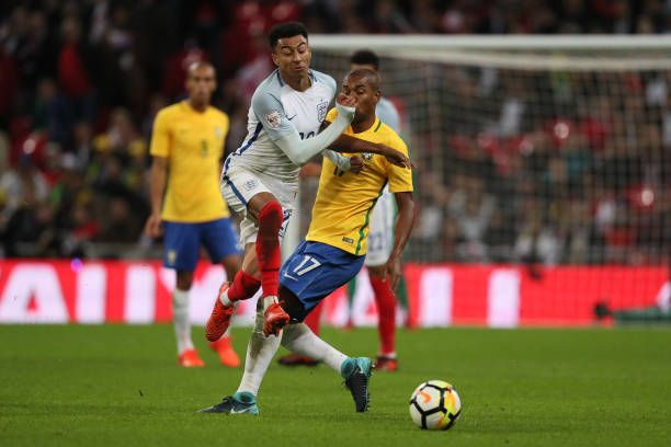 Jesse Lingard of England competes with Fernandinho of Brazil during the international friendly match between England and Brazil at Wembley Stadium on...