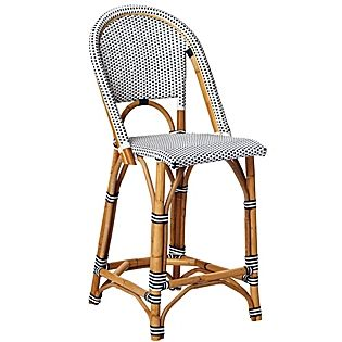 Sustainable rattan and woven plastic. Don't leave chair exposed to inclement conditions. Store indoors when not in use, to preserve its beau...