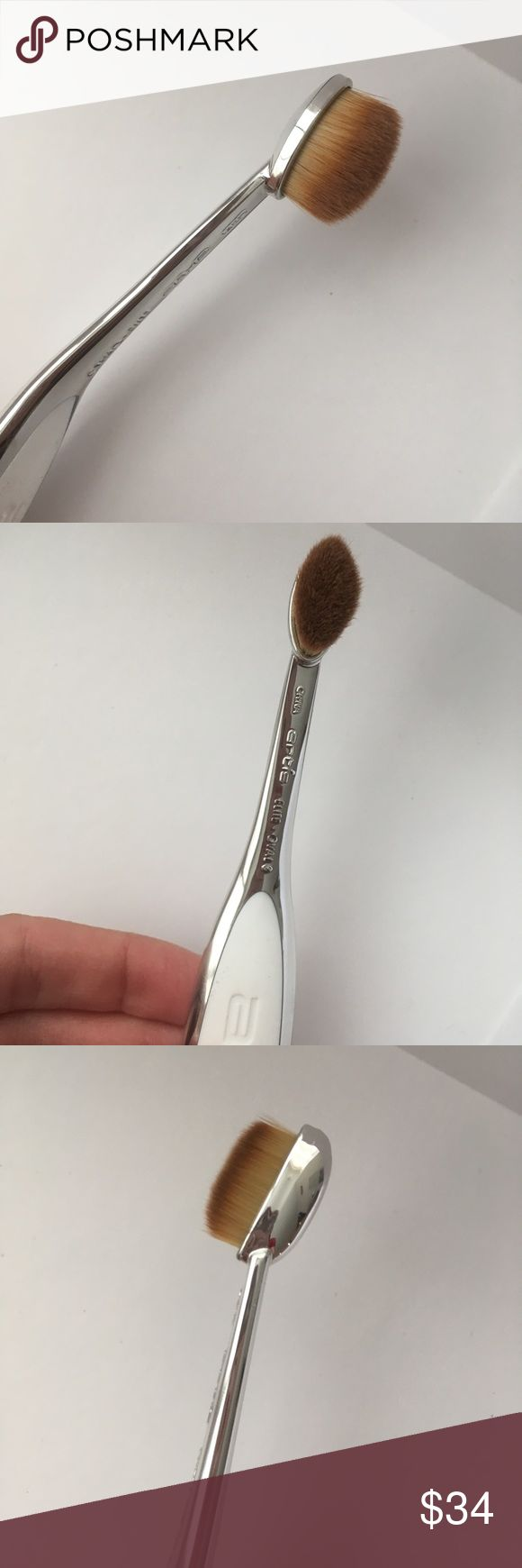 Artis Elite high quality makeup brush Oval 3 NEVER USED.  The Artis Elite Oval 3 assists the user in shading and blending the products applies to the outside and inside corners of the eyelid and smaller areas of the eyelid.  Great for concealer, foundation and contouring.  High quality professional make up brush! Artis Makeup Brushes & Tools