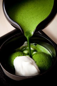 In this photo, the colors green, white, and black are perfectly balanced and delicious to the eye, and green tea ice cream is delicious to the taste buds. Beautiful picture. Japanese Matcha ice cream