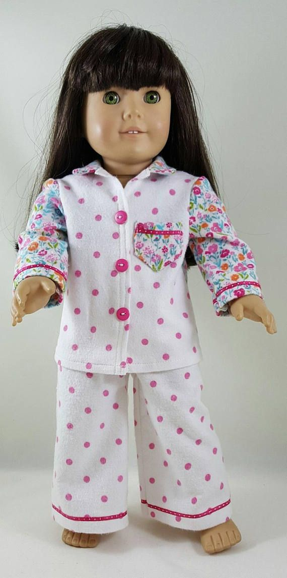 Two piece pajamas made to fit 18 inch dolls available in the following fabrics: 1. One-of-a-kind pink polka dot two piece flannel pajamas with hot pink polka dot ribbon accents. The pajama top front is pink polka dot with a pocket of pink floral with ribbon detail. The pink floral is