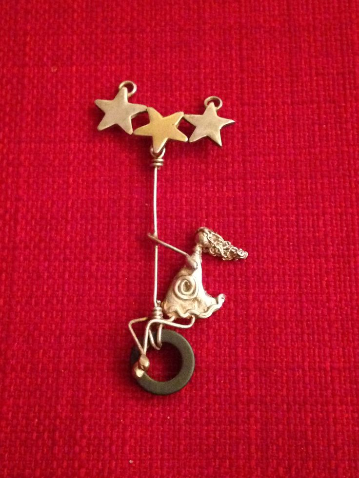 Girl on a swing pendant hand made by Helen Green using silver clay, silver wire and hematite bead.