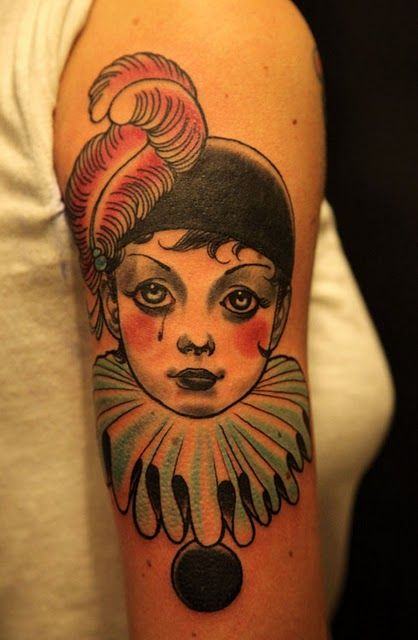 Oh, hi! I am a clown, and I am on your arm making you happy.