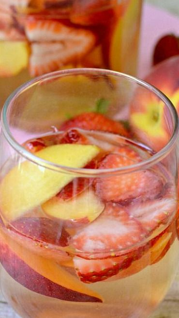 Strawberry Peach Sangria Don't forget to come to Happy Hour.