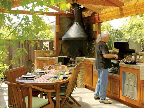 A tiny backyard is transformed into a spacious outdoor kitchen. A covered pavilion and custom wood- and gas-burning grills allow this Napa, California, couple to entertain outdoors year-round. (Photo: Thomas J. Story)