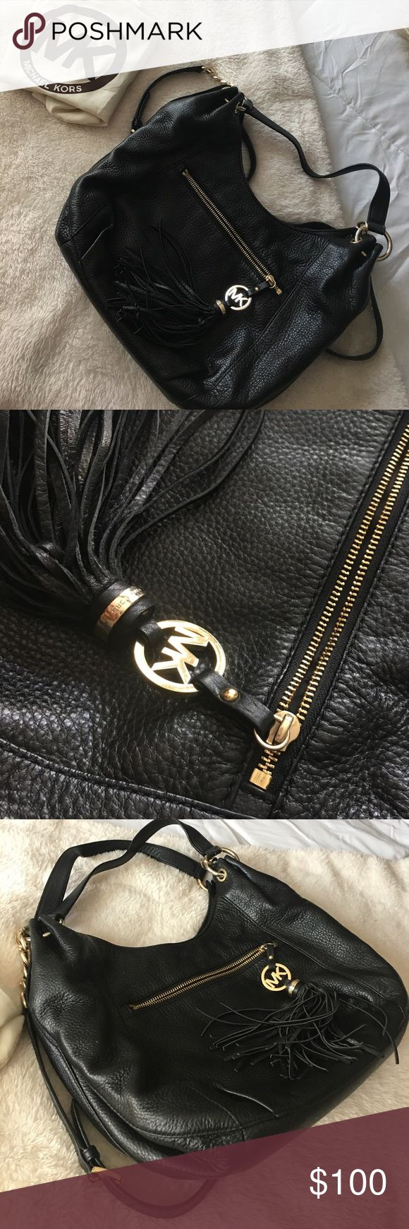 Michael Kors Black Bag This bag is black with a small tassel that includes MK logo. It is in pretty good condition. If there are any specific questions just ask below. The dust bag is included and I'm willing to negotiate the price! Michael Kors Bags
