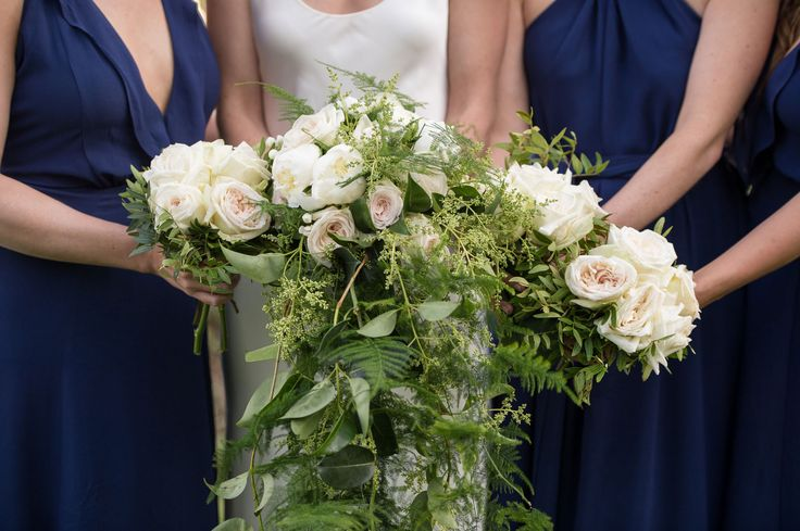 An amazing flower composition made of four different bouquets! White roses, peonies and schinus flowers!