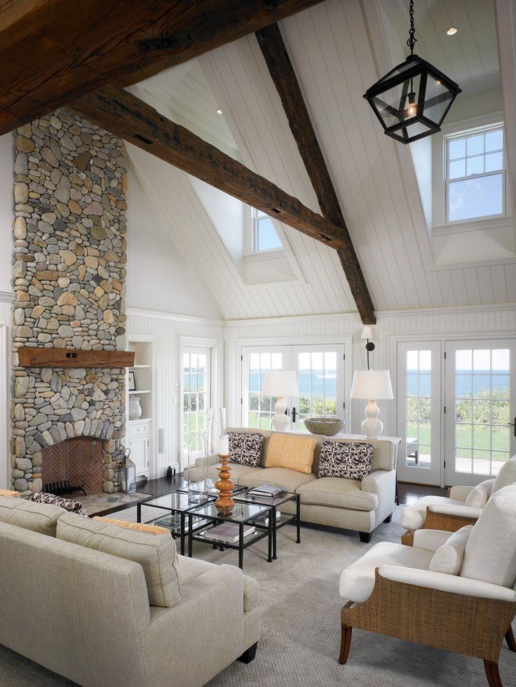 Remarkable Vaulted Ceiling decorating ideas for Delightful Living Room Beach design ideas with beadboard walls beige sofa dark ceiling beams dormer windows exposed beams four
