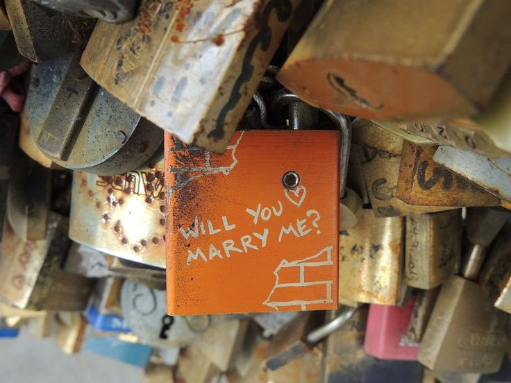 the idea of using love locks  to raise funds for refugee charities in Paris
