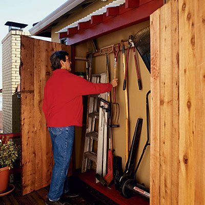 This is a really good garden tool storage idea. build the back wall of the shed in a bit from the structure, and then frame in some doors for the exterior wall, using the solid back wall to store tools pegboard style. You could also keep pots, fertilizer, etc in there. I may just have to add this on to the kids' playhouse plan.